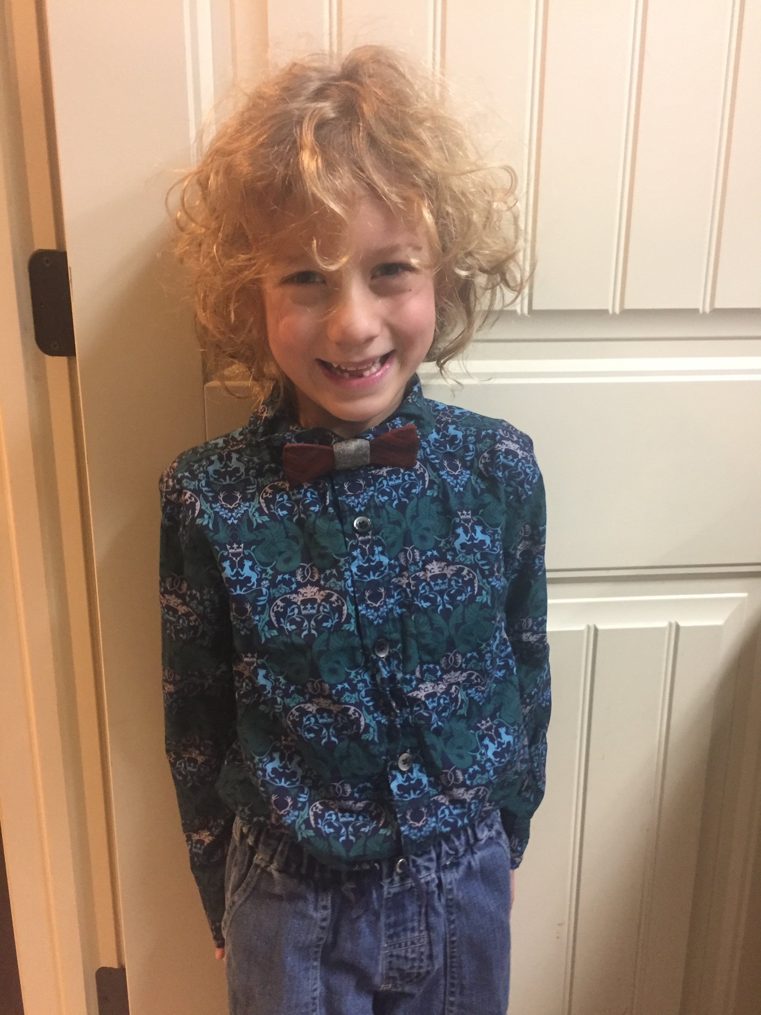 December 2017  DZ loves picking fancy clothes!  He picked this shirt, and I got him the bow tie as a surprise for the Winter Concert dressy day =)