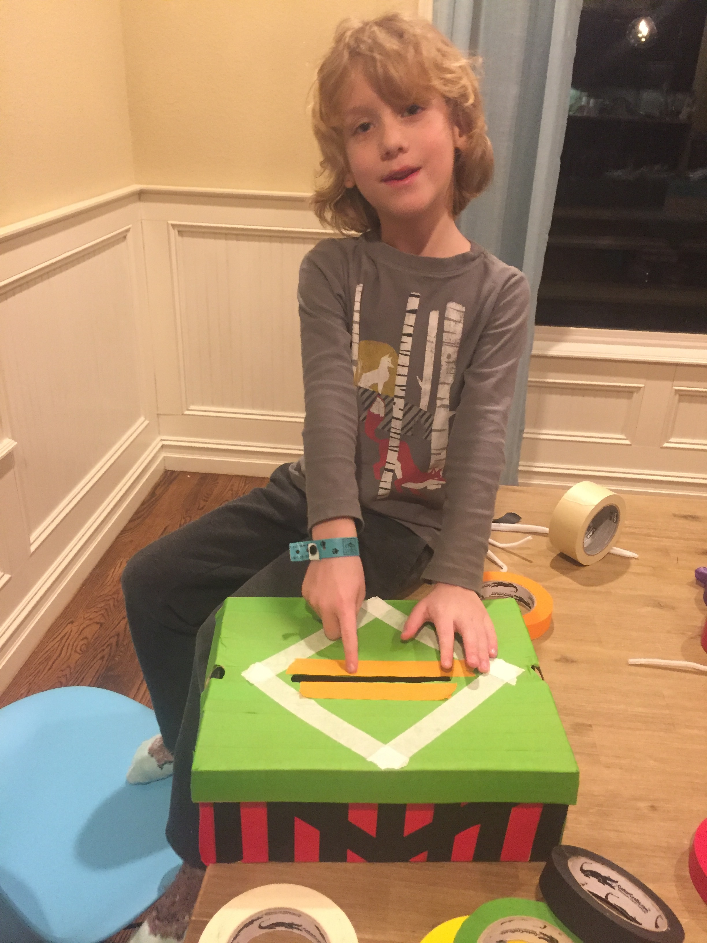 January 2018 Making his Valentine Box for school.  DZ takes deadlines very seriously, he works hard on things as soon as he knows about them!