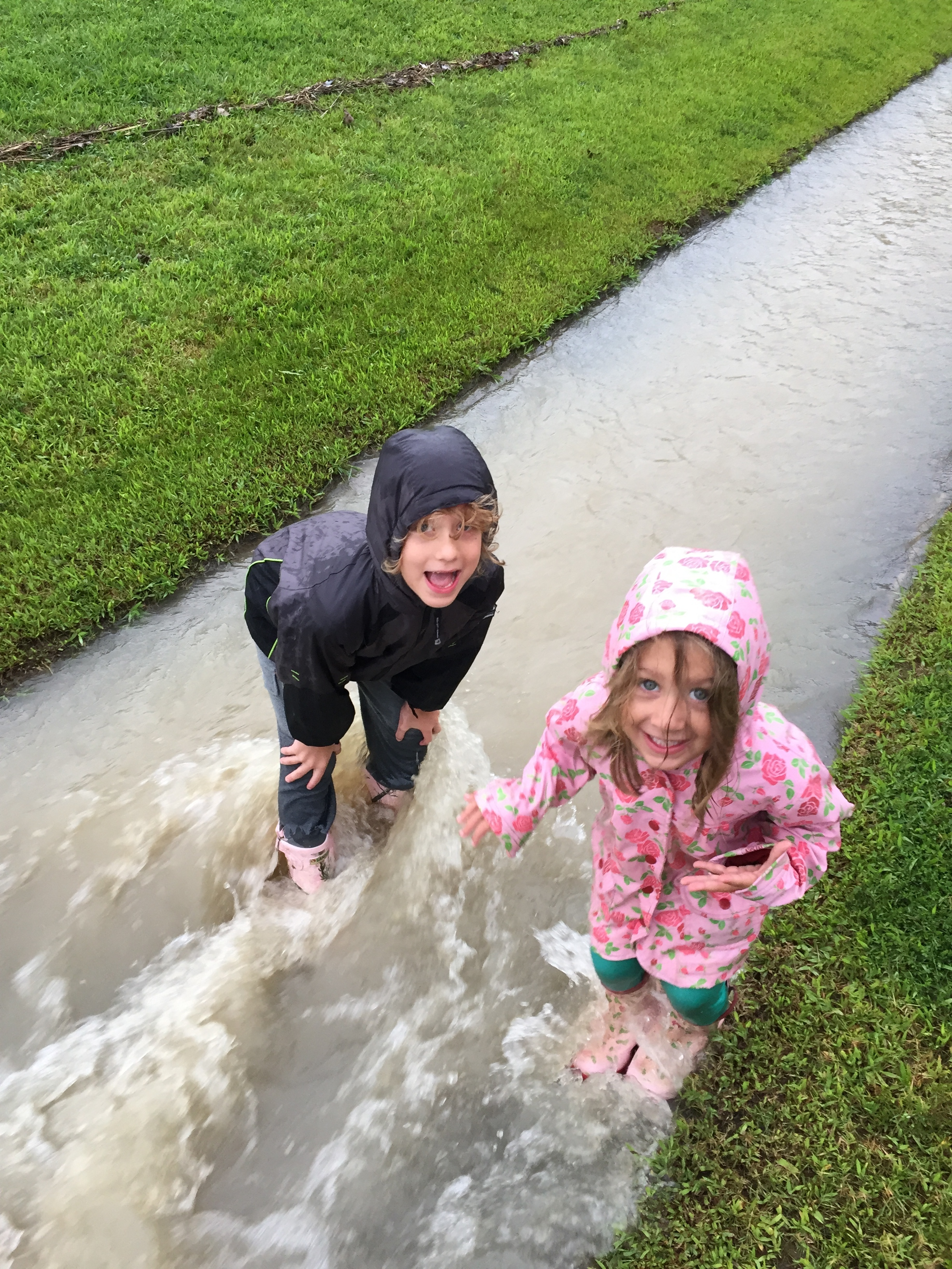 We had a ton of rain one week!  The kids suited up and splashed around with Daddy!