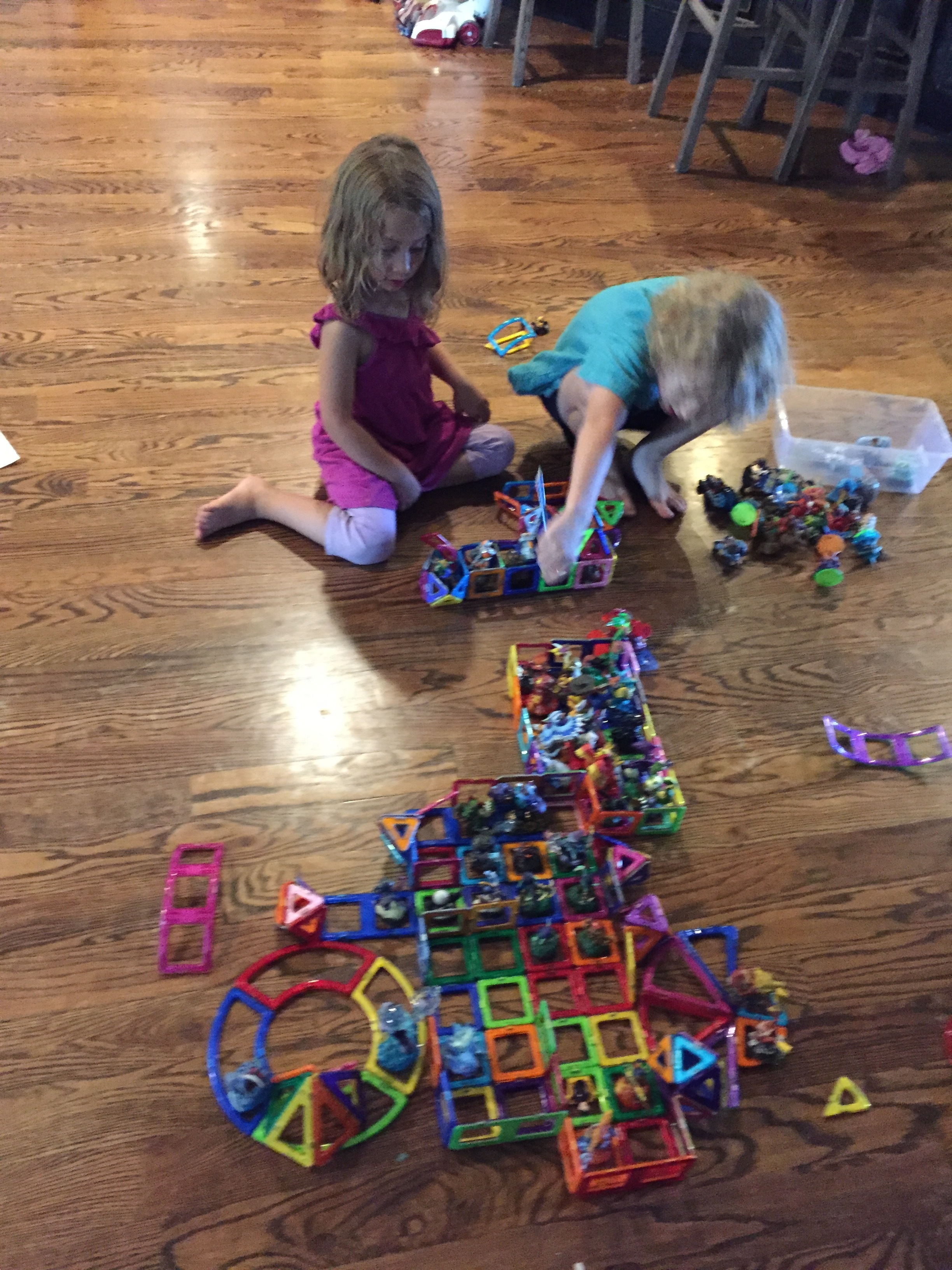 This is Donovan and Maia's favorite activity to do together right now.  Building homes and traps out of Magformers for the Skylanders!  Sometimes they add Lego Duplos!