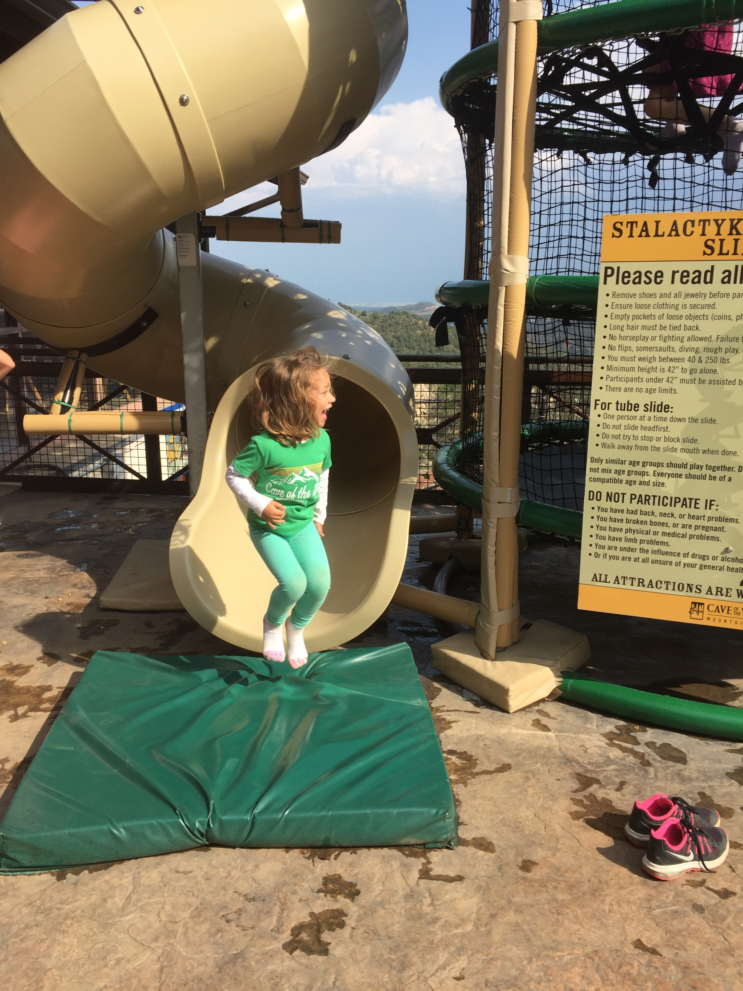 Maia was SO proud when she finally climbed to the top of this net climber and could slide down the slide!