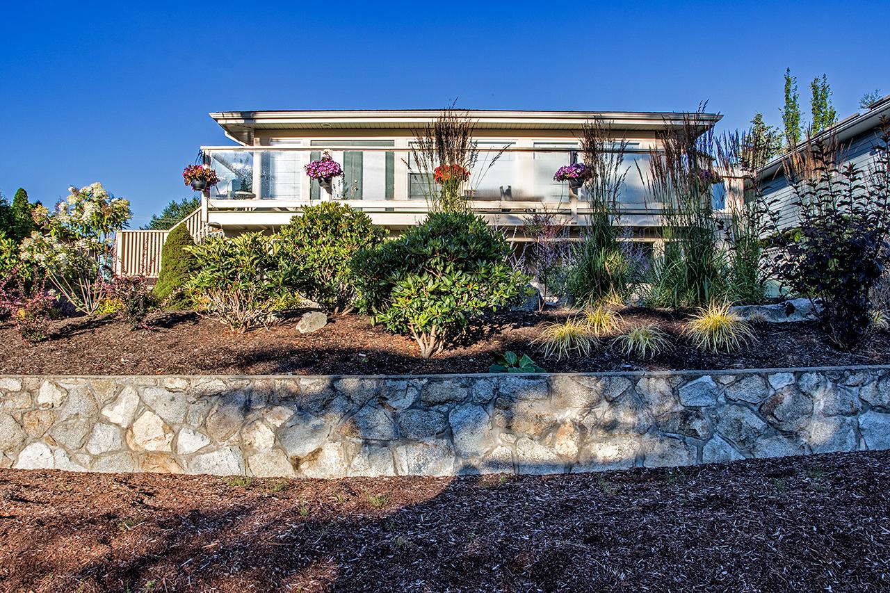 Beachside-Perennials-grasses--MustangLandscape-Victoria-BC-garden-rock-wall.jpg