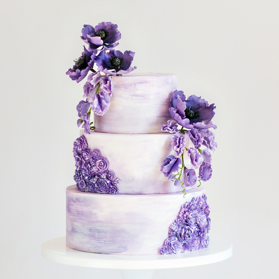 Purple watercolor wedding cake with sugar poppies and sweet peas