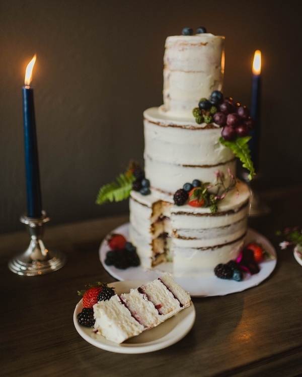 Moody Semi-Naked Cake with fresh florals and fruit