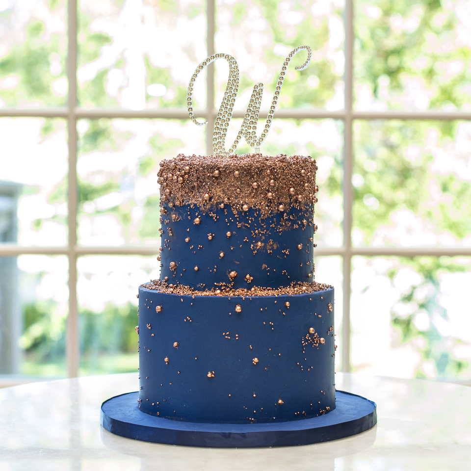 Rose Gold and Navy Blue sugar and pearls wedding cake