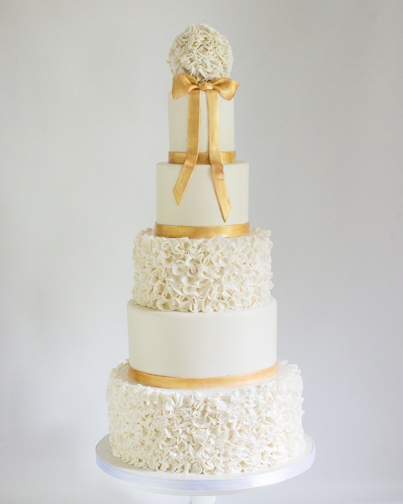 Ruffles and Champagne Gold wedding cake