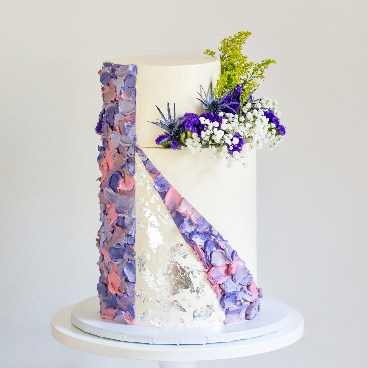 Purple Geometric textured Buttercream with silver leaf and fresh flowers