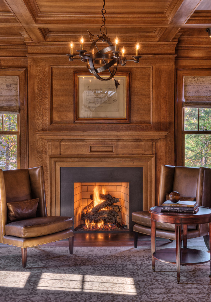 Leather chairs in front of fire place