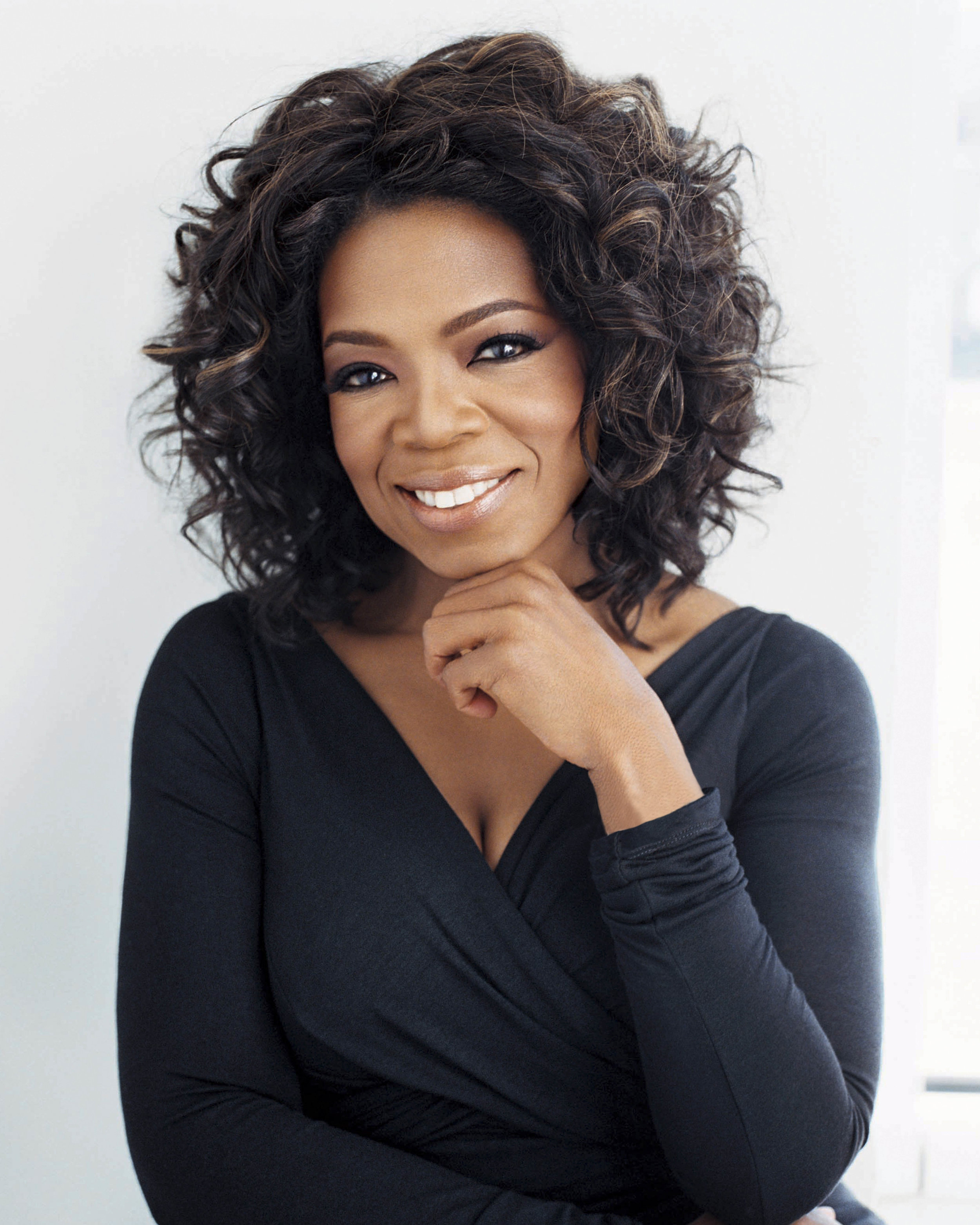 Oprah Winfrey - First woman to own, produce, and host her own talk show