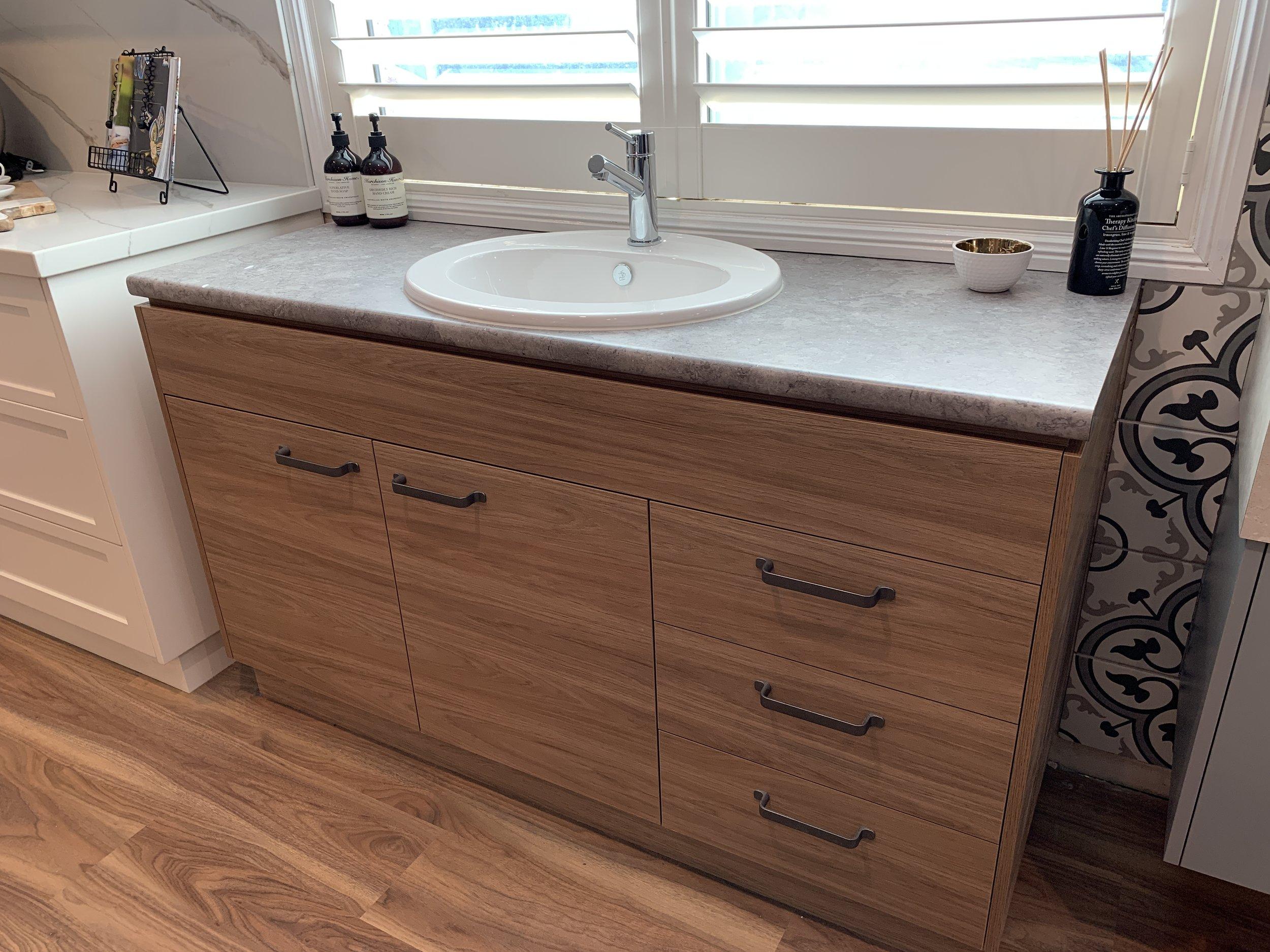 Drop In Vanity - Bench Top: Wilsonart Benjamin Grey (10 x 10)Cupboards: Polytec Prime Oak WoodmattHandles: Kethy L833 165 Rustic Grey Finish