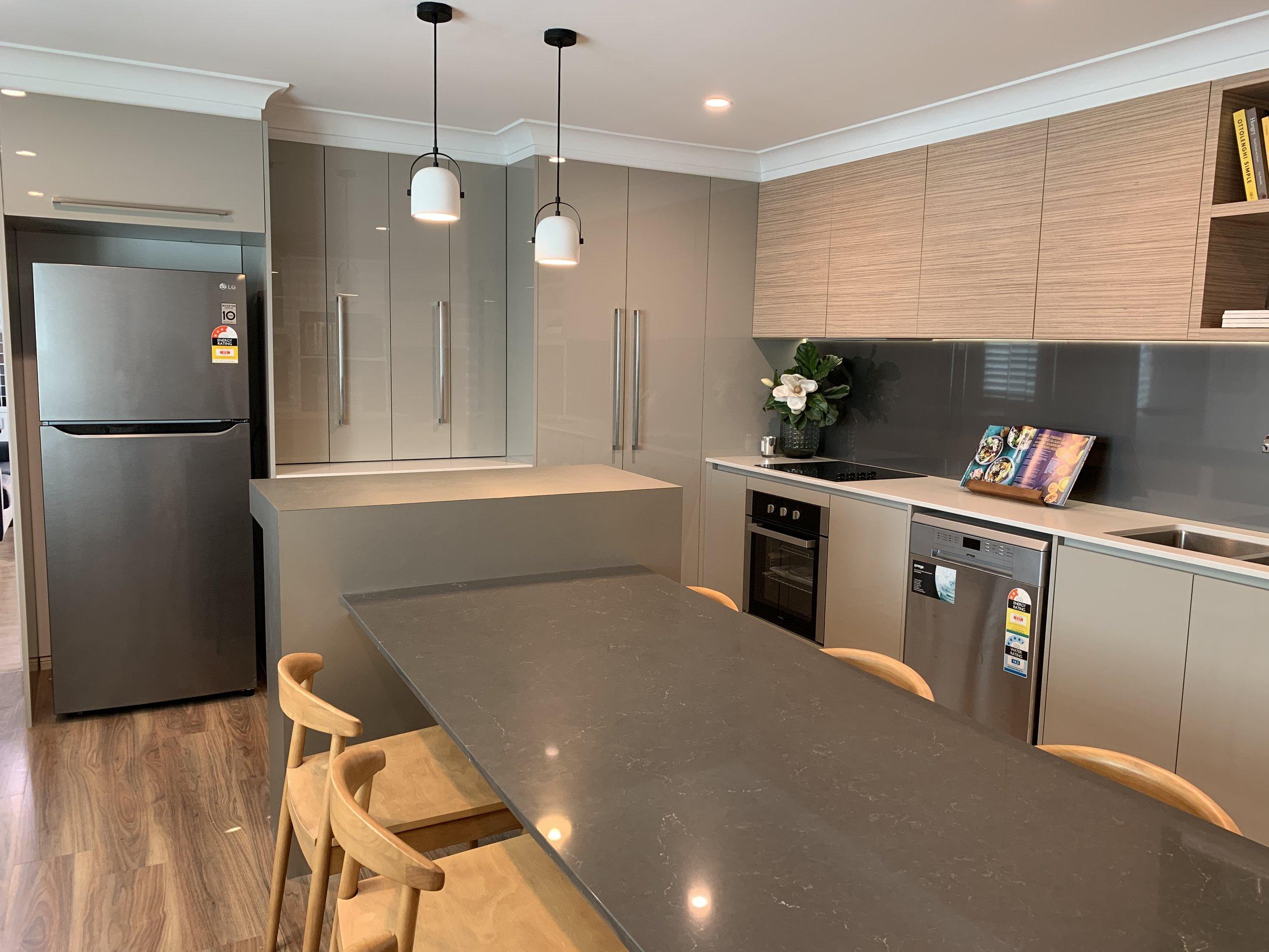 Kitchen - Bench Top: Caesarstone Fresh Concrete (20MM)Cupboards: Polytec Stone Grey CreatecOverheads: Polytec Satra Wood RavineSplashback: Laminex Metaline Nimbus
