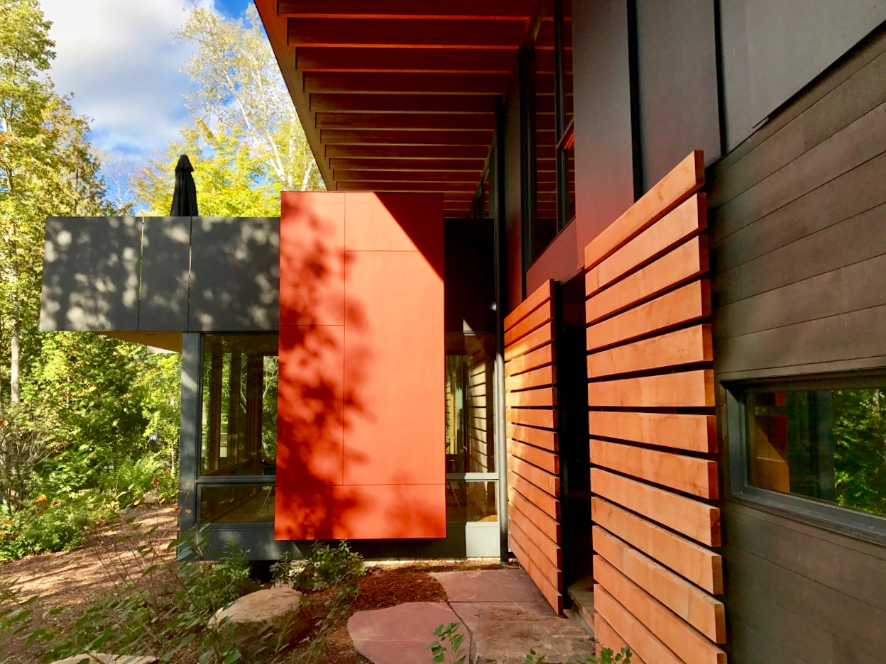 A Vibrant Autumn Sun Illuminates This Modernist Facade