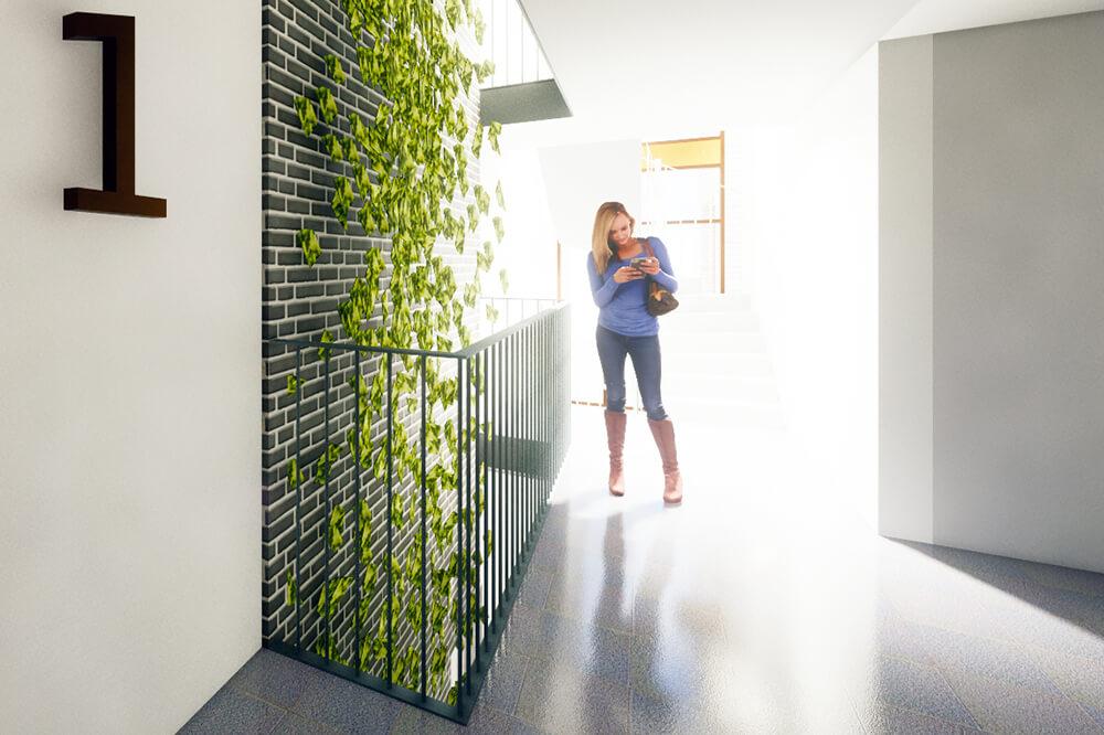 Grönskande trapphus - En idé som varit bärande genom hela projektet är våra två generösa uppglasade gröna trapphus, kallade noder i projektet. I öppna schakt från källaren till översta planet klättrar växtlighet