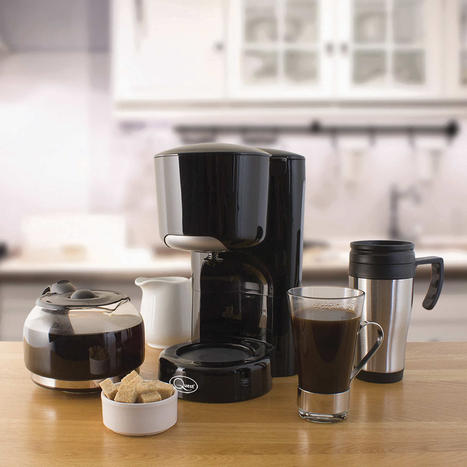 Black coffee maker in the kitchen with a cup of caffee