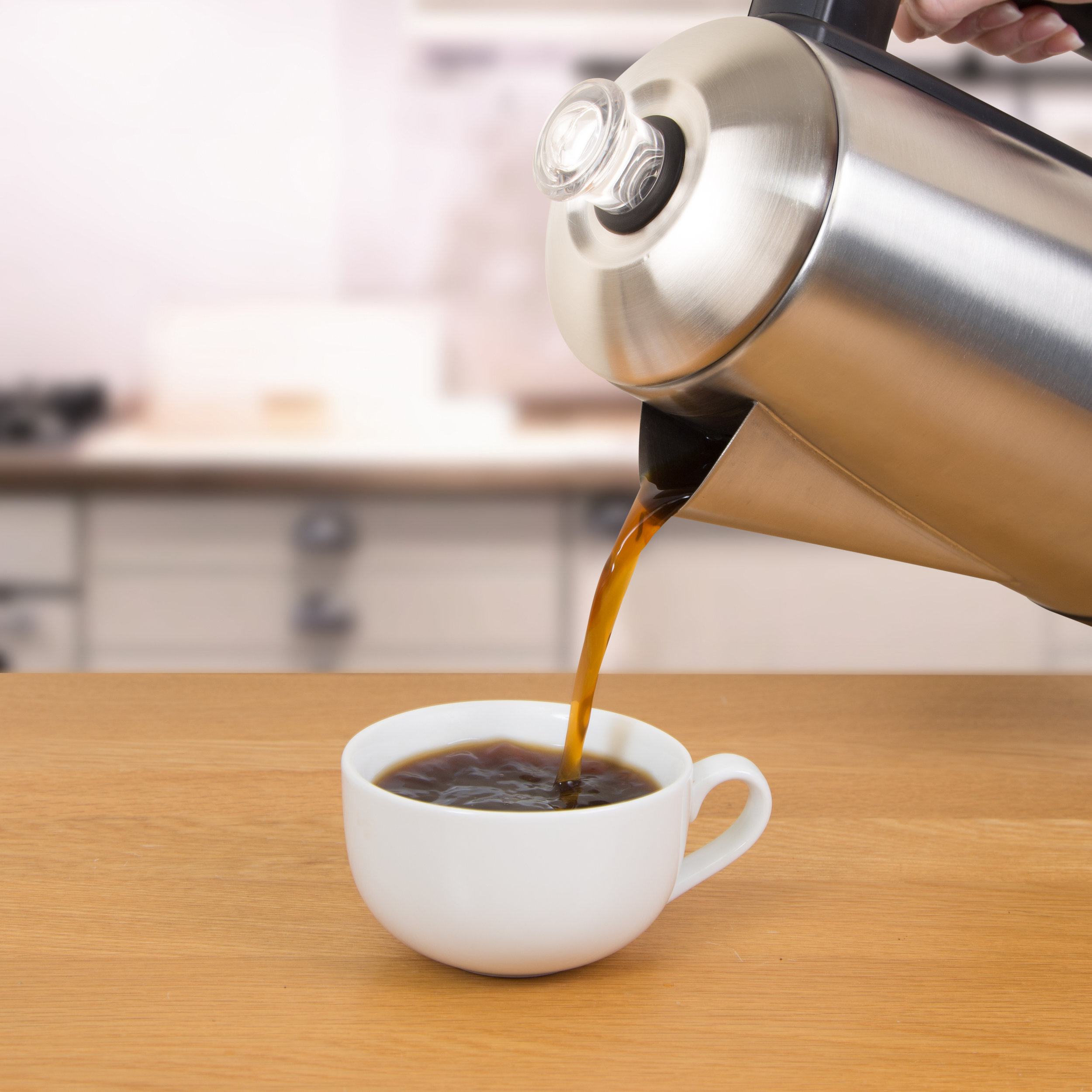 Pouring coffee with the 1.5L Electric Coffee Percolator