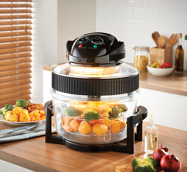 Multifunction Air Fryer Oven on the kitchen table cooking vegetables