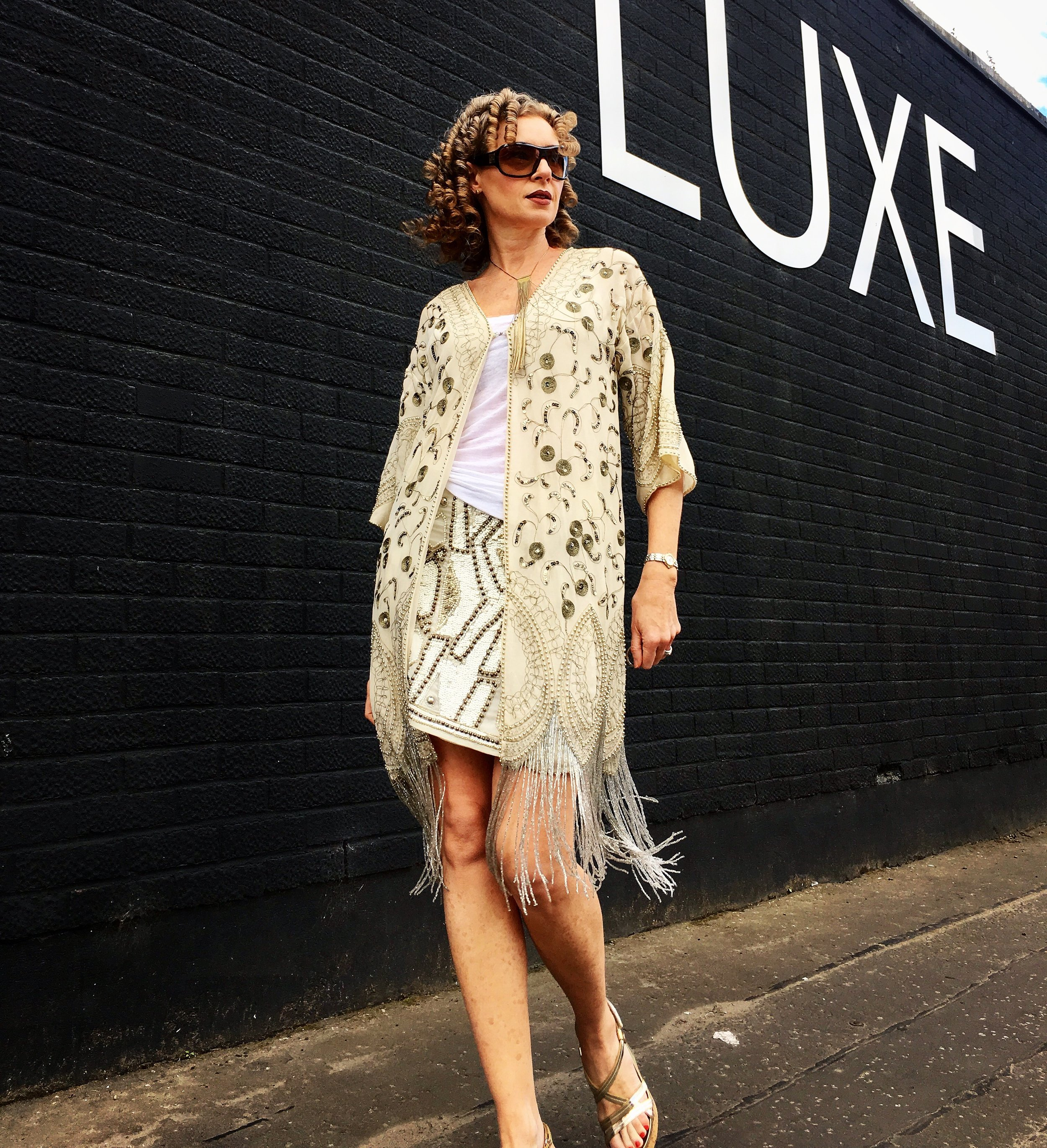 This statement, beaded kaftan was purchased on sale and is something I'll love wearing for decades! It can be dressed up or down - perfect with blue jeans and a white tee.