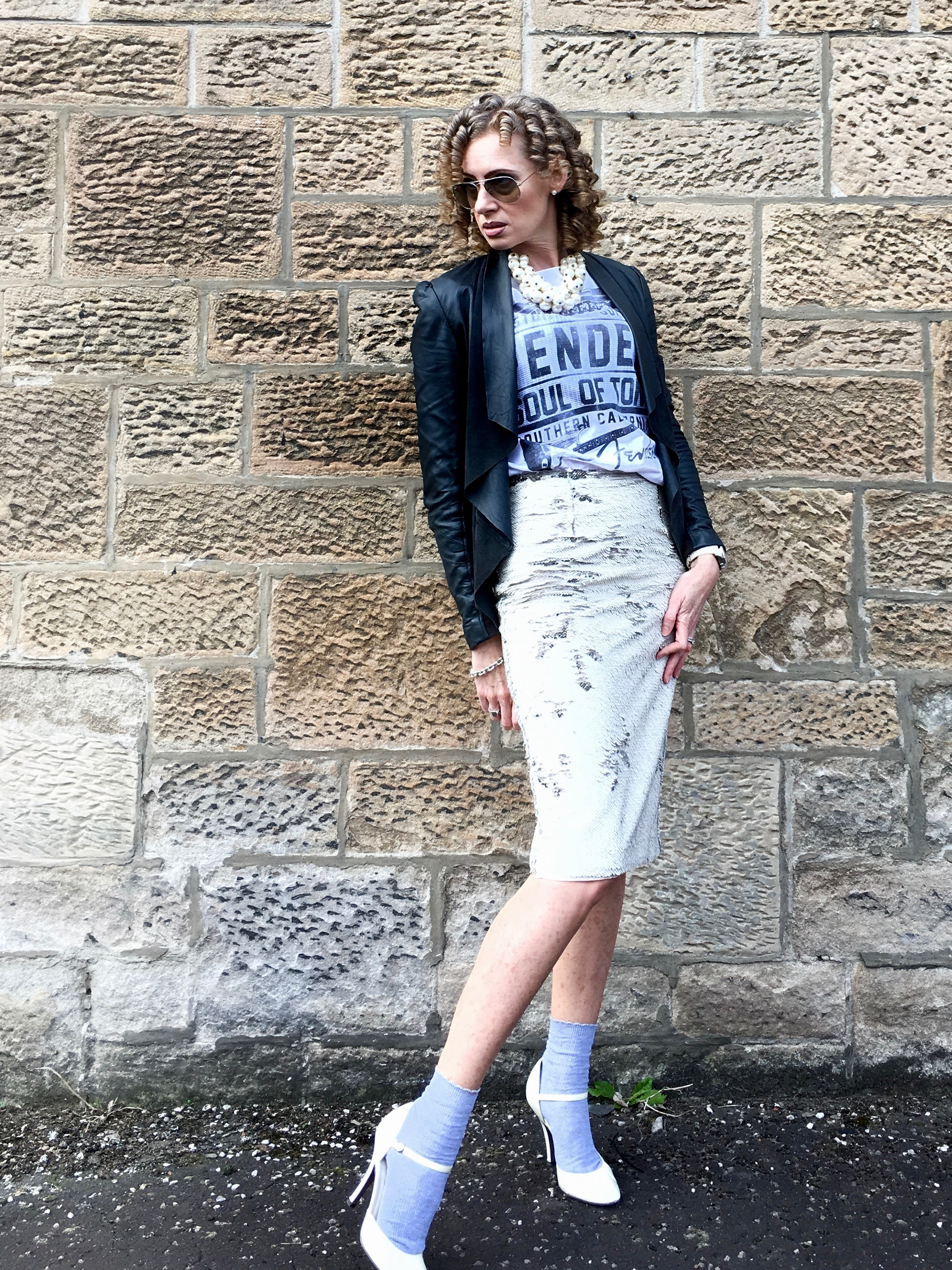 Weekend warrior: a sequinned skirt paired with band tee and leather jacket creates an interesting spin on weekend wear - ankle socks optional!
