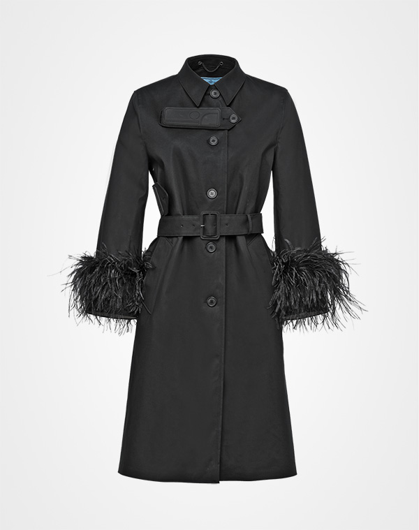Right now - Prada.com features the most prêt-à-porter plumage in the form of jeans and trench coats. And they're selling out fast! Proof positive that real women can and are wearing feathers? Perhaps...