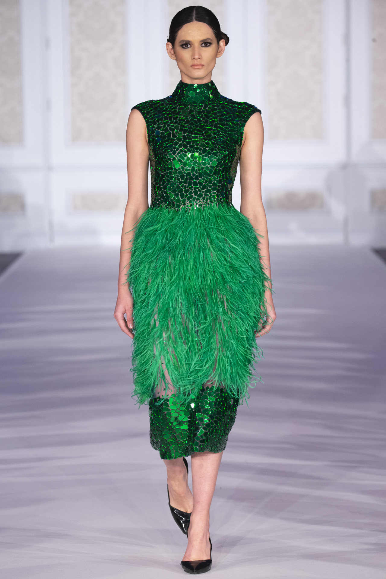 atelier zuhra   AW19 - A treasure-trove of jewel-tones in feathers, silk, satin and tulle.These gowns are the stuff of dreams. Vivid, technicolour dreams, that is. Every stone, from emerald to amethyst, ruby to sapphire and yellow diamond, were represented in these fantasy fashion frocks.One model, one dress. The extravagance was real, and the setting, The Connaught Rooms, suitably opulent.Photos: Simon Armstrong