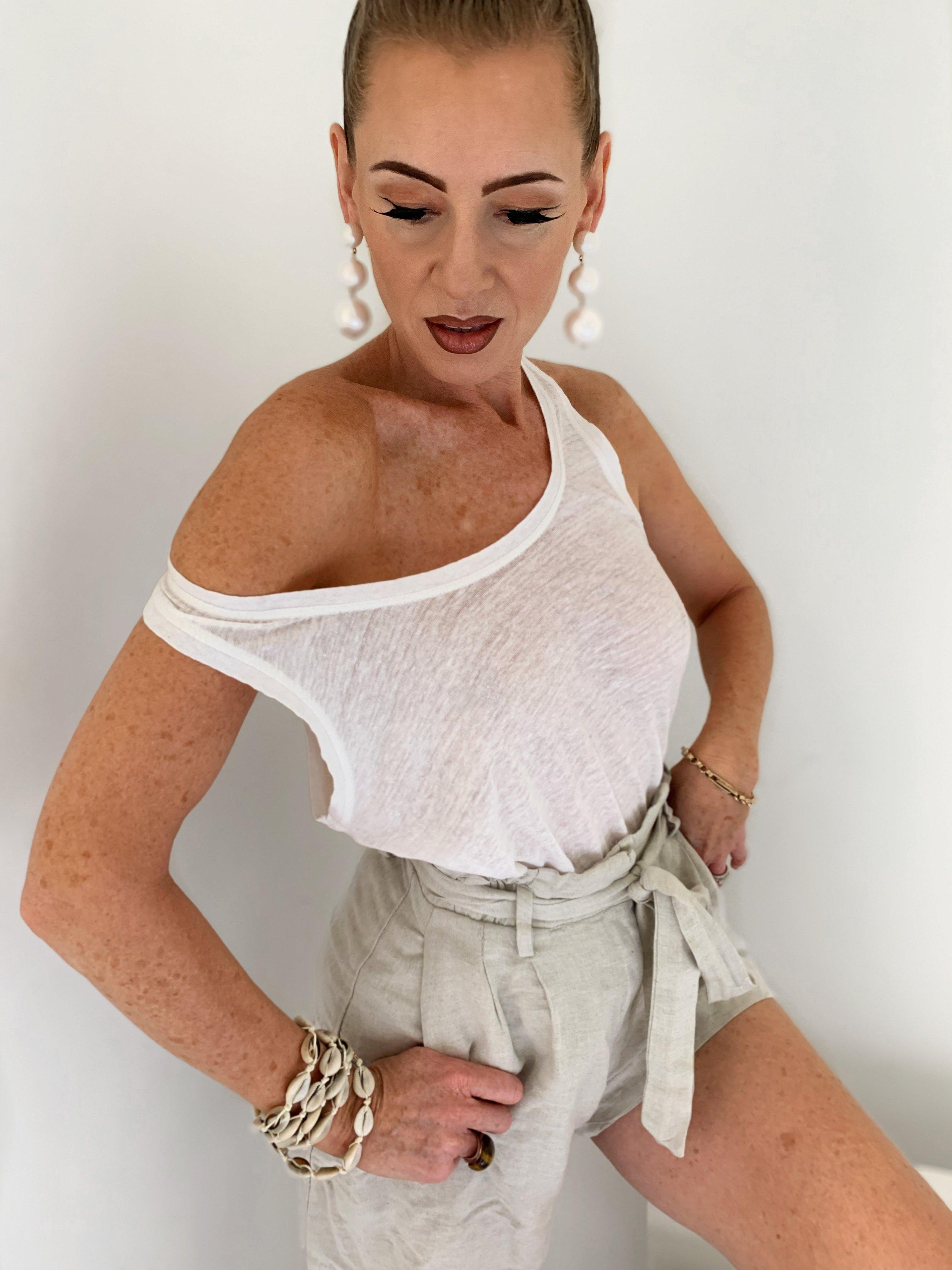 Wearing Tan Luxe gradual self tanner in Light/Medium