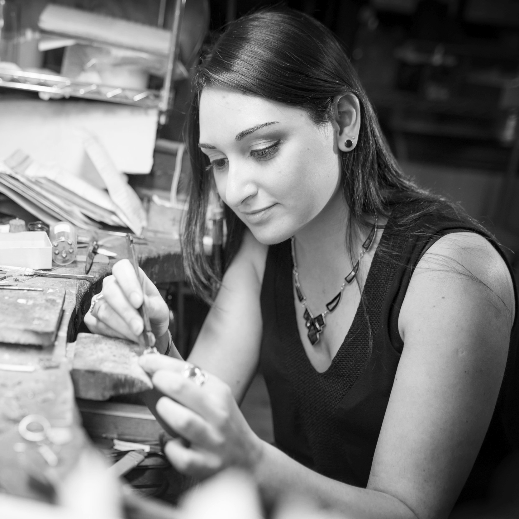 """Ana Tkabladze, Manager   Originally from Georgia (the country, not the state), Ana moved to Virginia as a child and has lived in the DC region ever since. As the daughter of two accomplished artists, Ana grew up surrounded by an array of creative outlets but she was drawn to the craft of jewelry making at a young age. Now a full-blown """"obsessive addict"""", she has studied enameling, metalsmithing, and works with our CAD software for jewelry design. Ana travels extensively (when she can) and will bring you delicious Georgian food (if you ask nicely)."""