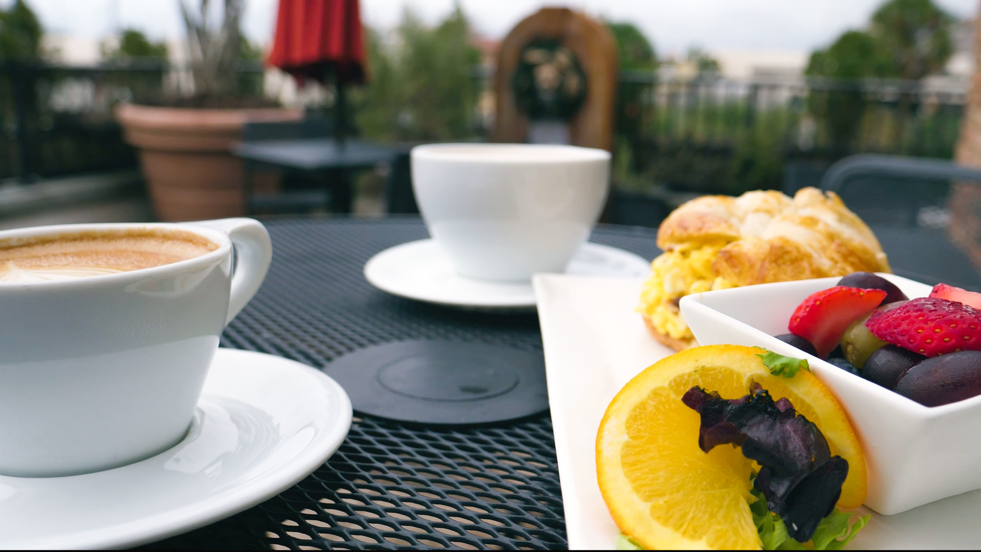 Coffee and breakfast on a rooftop at Bodacious Brew on Palafox Place - just one of many options for your morning in downtown Pensacola!