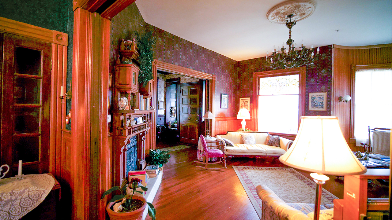 If you look closely at this photo, you'll see the details in the character of this home. The old fashioned wallpaper, the candles on the walls, the rugs, the chandaliers...