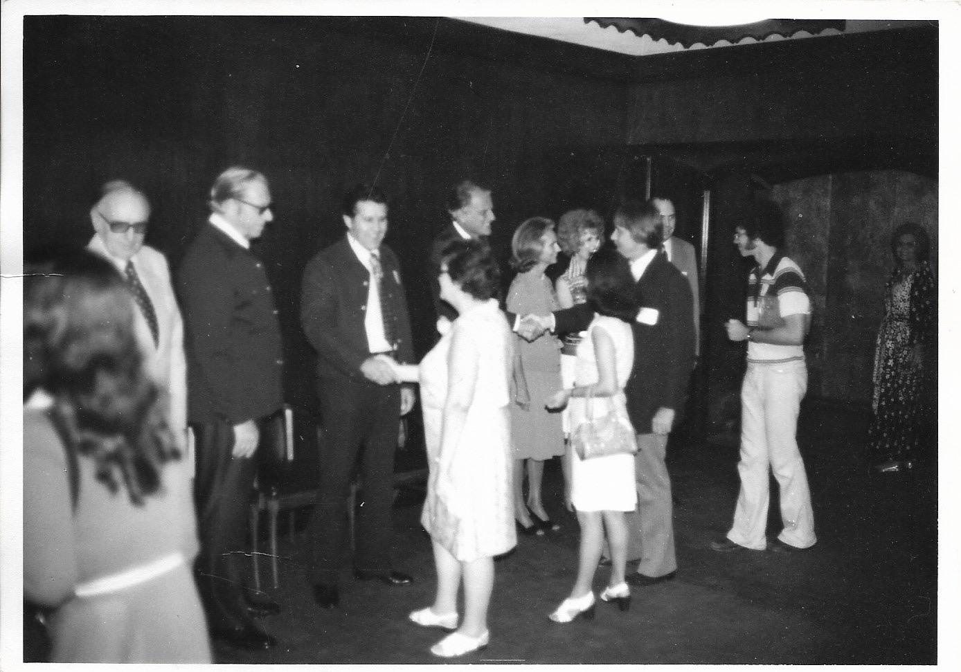 Dad is center, shaking the Reverend's hand and my cute, chic mother is on the left of Dad.