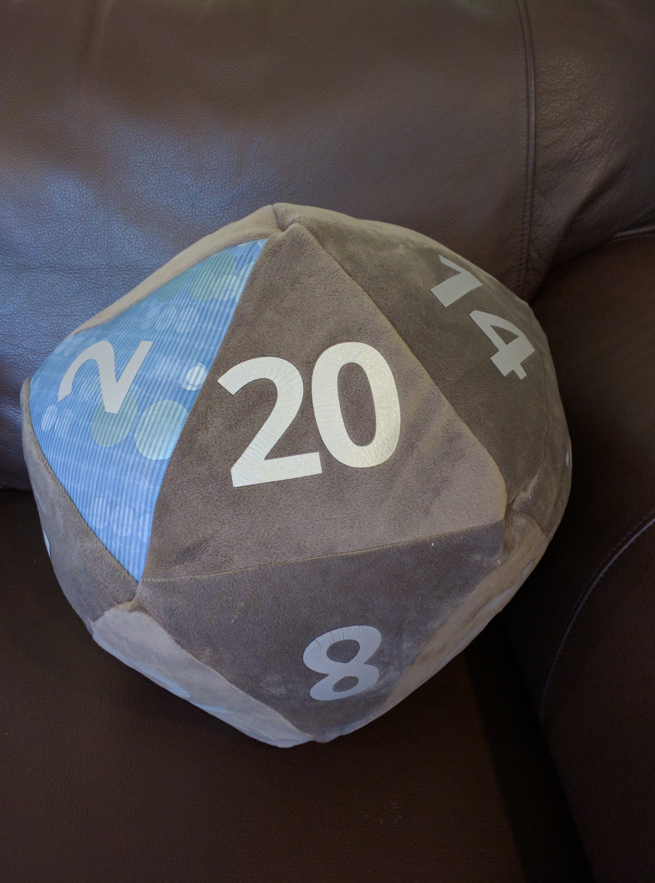 A custom made die with grey velvet and blue vinyl on the Primes, with silver numbering. So soft!