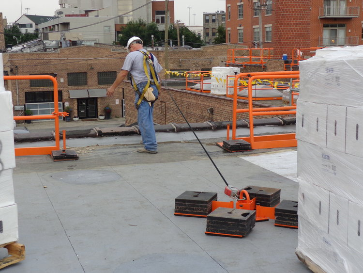 Single Man Tie-Off SystemSwitchRail Safety Systems continues to develop labor and cost saving products like the Single Man Non-Penetrating Tie-Off Anchor, providing fall arrest and/or restraint for a single person (patent pending). -