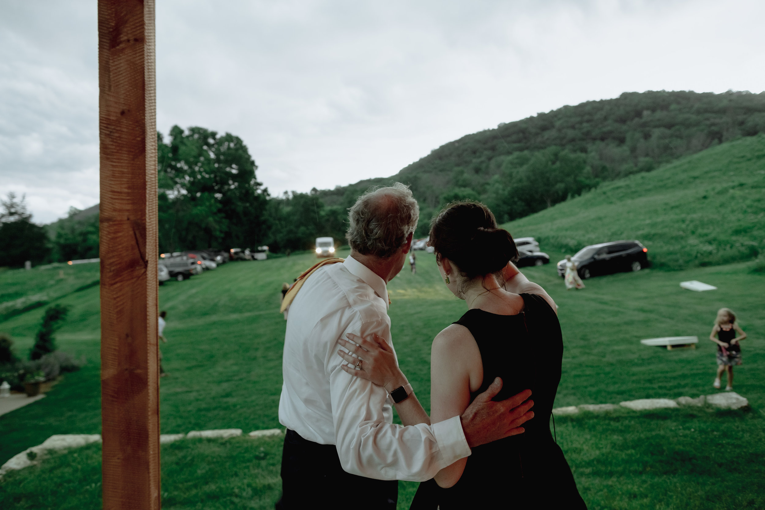 "I don't typically include photos of myself on blog posts (but shout out to Ray+Kelly for actually getting me in a few ""action"" shots - I rarely get photo evidence that I was actually there on the wedding day!). This is the Father of the Bride and me making the call to not only move the ceremony from the (potentially dangerous) hilltop location to the pavilion, but to delay it while we wait out the storm moving in."