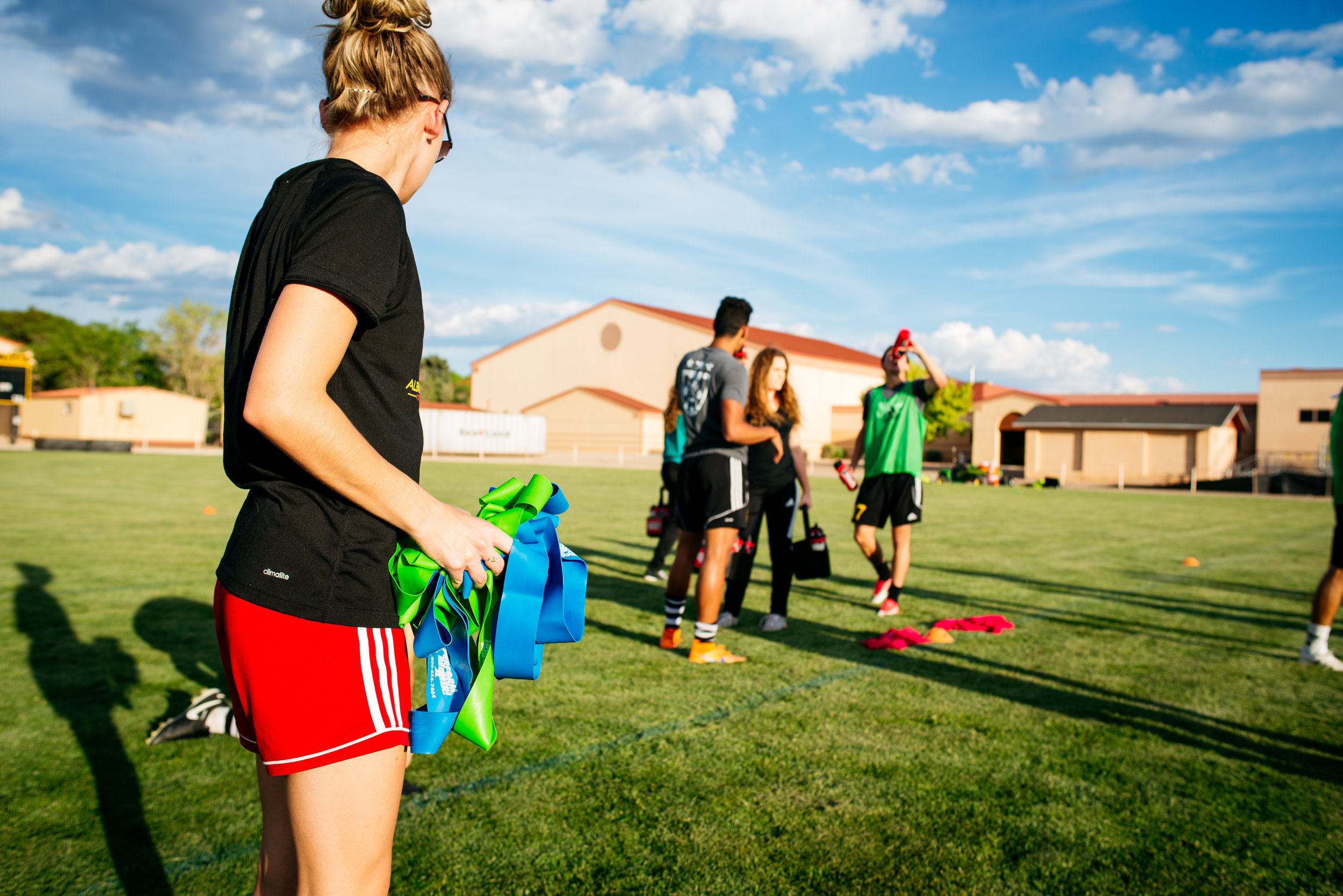 Julie Holt, athletic trainer for the Albuquerque Sol, works with her team to help prevent injury.