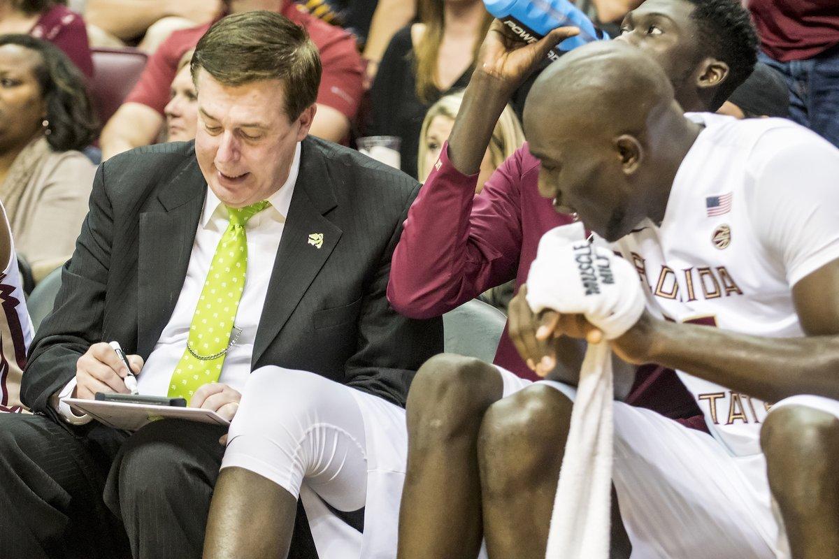Assistant Coach Stan Jones seen coaching in his Green4Literacy tie.