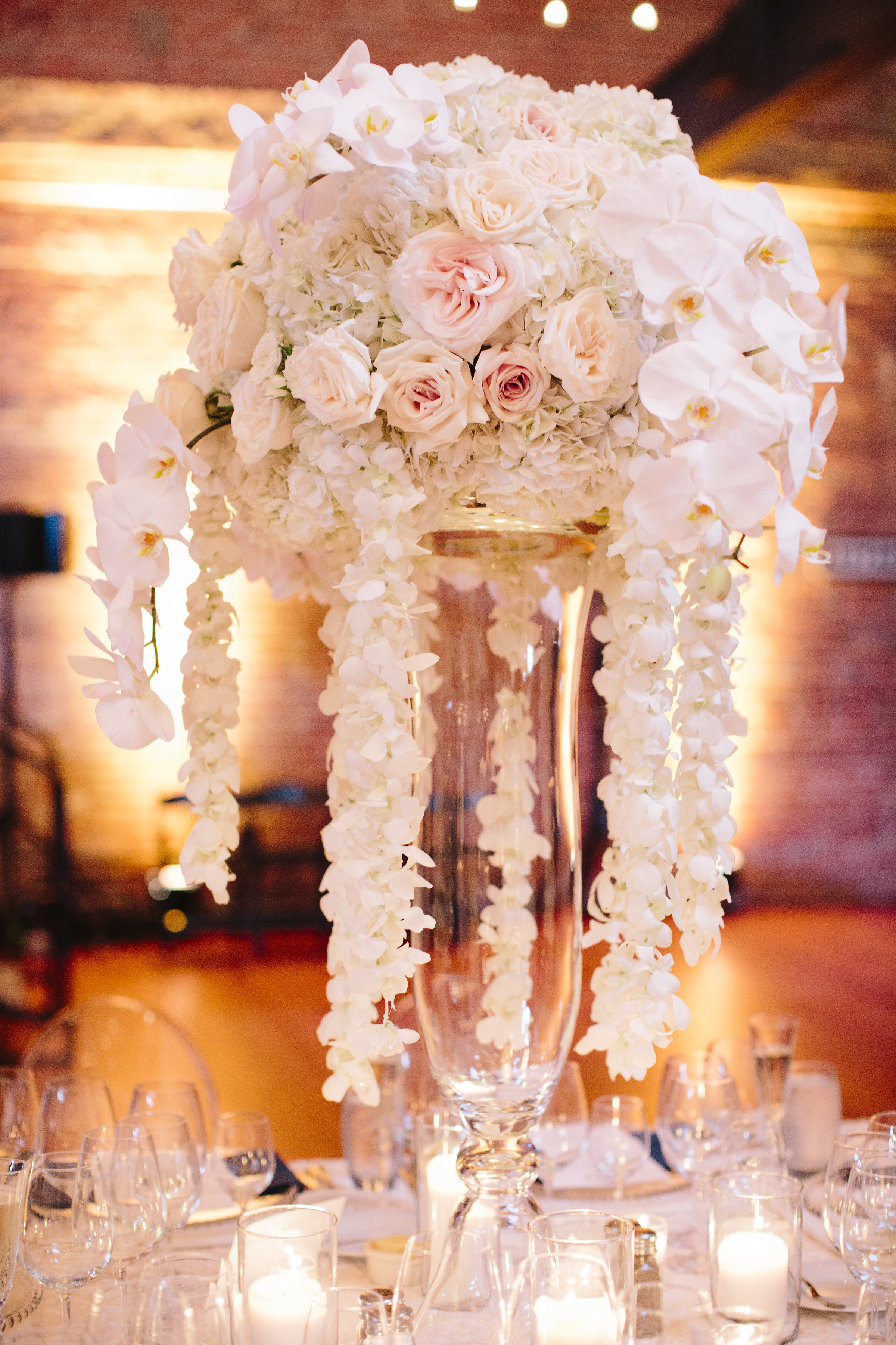 Pink and white rose cascade wedding centerpiece