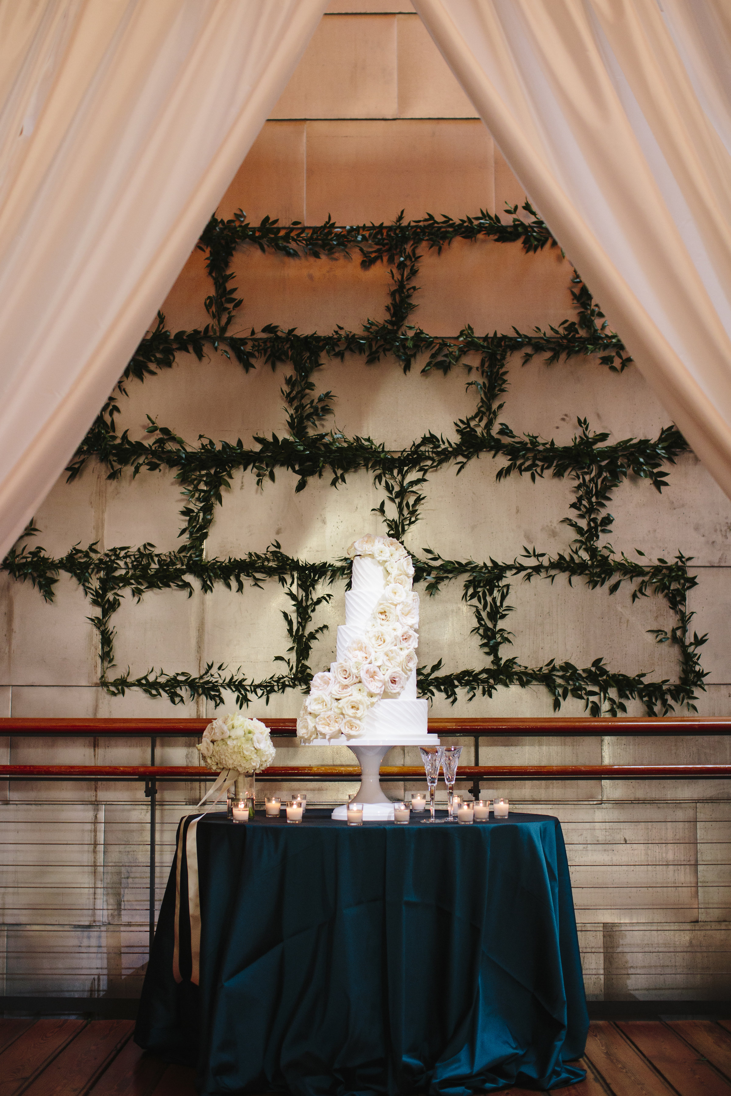 Classic white wedding cake with rose cascade