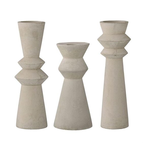 Concrete Taper Set - A unique gift for someone who loves to add interesting pieces to their home decor. We love incorporating unexpected textures and materials to tablescapes - these are definitely an eye catcher, we would pair with a pretty colored taper!