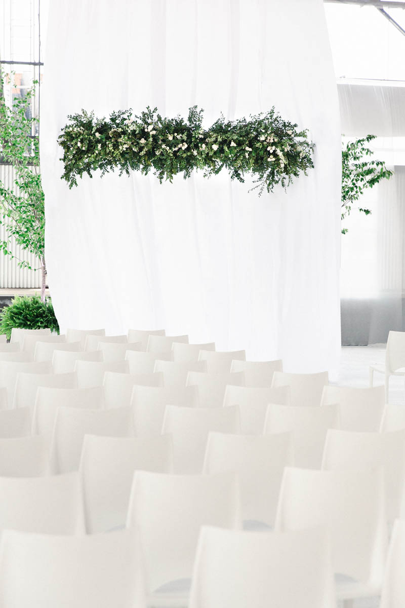 american-tobacco-campus-wedding-ceremony-white-chairs.jpg