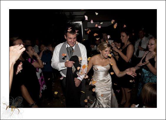 hilton-new-bern-wedding-bride-and-groom-showerd-in-rose-petals.jpg