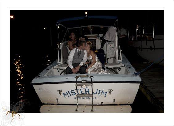 bride-and-groom-leave-by-boat.jpg