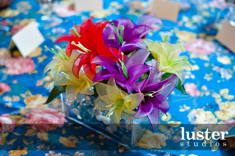 short-stemmed-flowers-blue-tablecloth.jpg