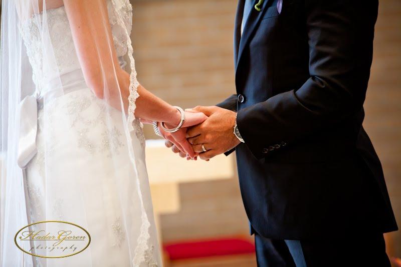 bride2band2bgroom2bholding2bhands1.jpg