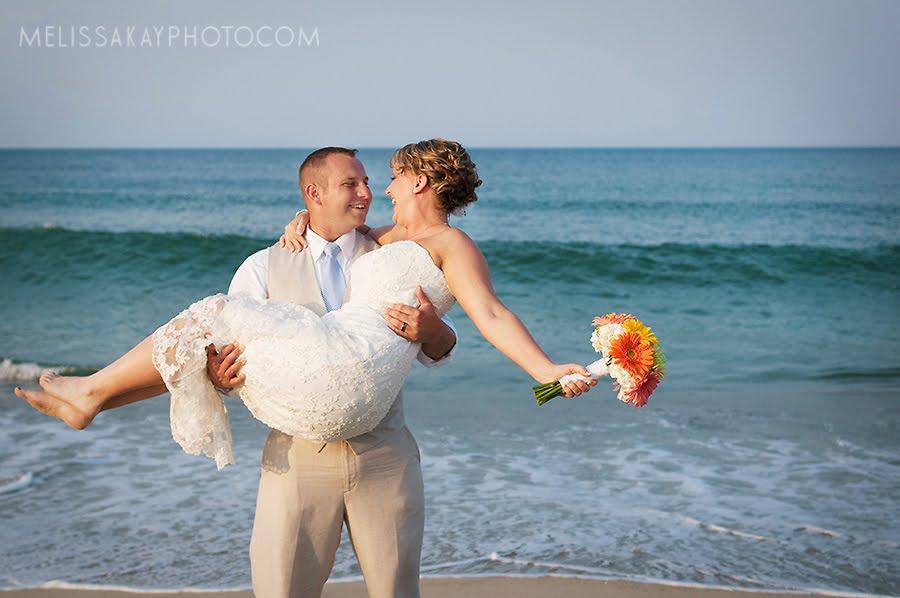 outer-banks-wedding-groom-holds-bride.jpg