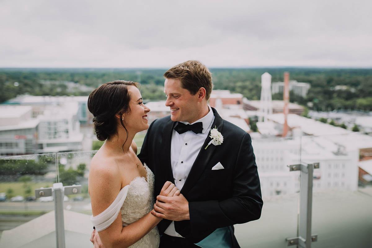 Bride and groom on Durham NC rooftop