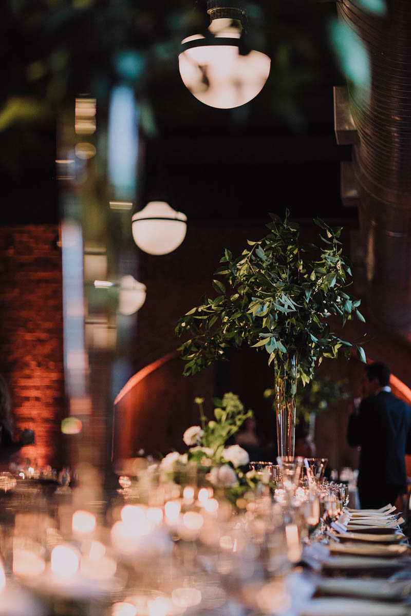 Tall centerpieces of greenery at The Cookery Durham wedding