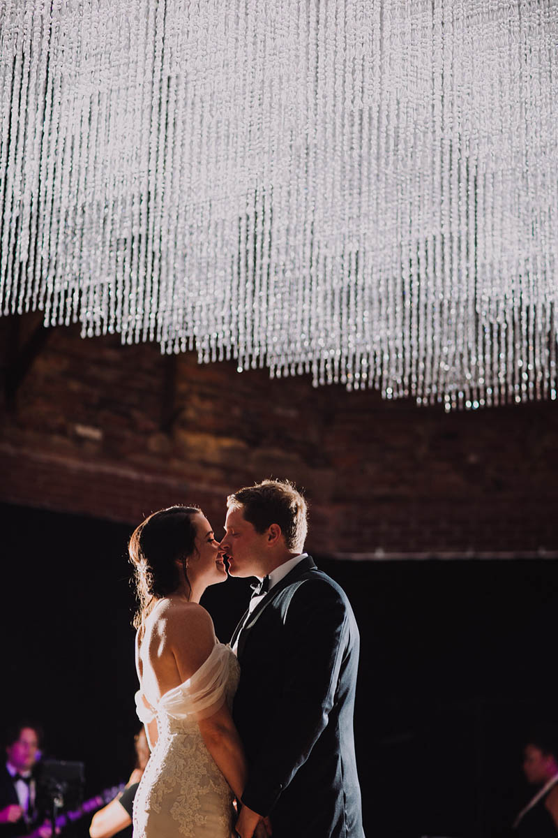 Bride and Groom first dance under crystal lighting