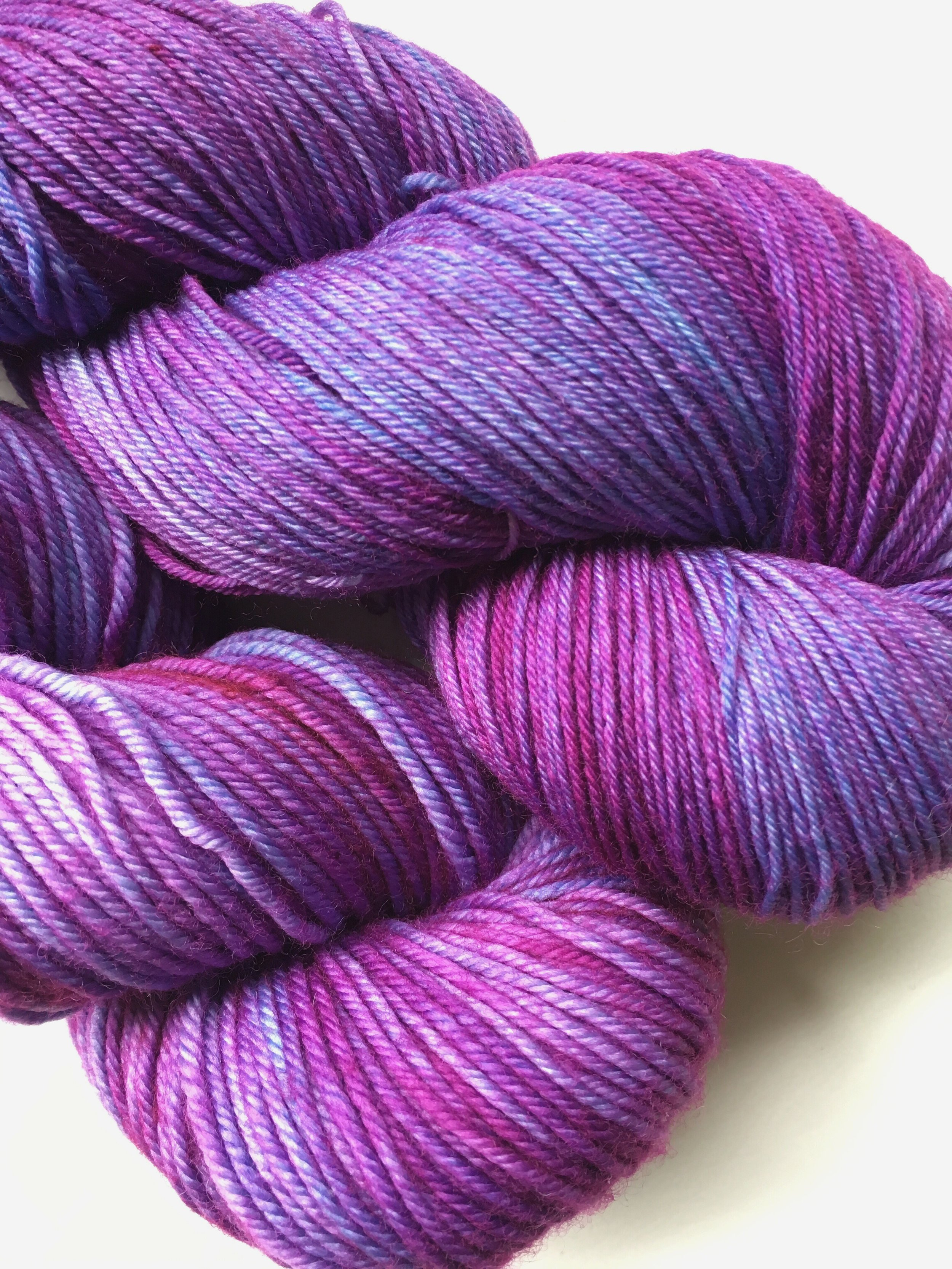 Wolfsbane  Shades of blue, purple, and magenta, reminiscent of the wolfsbane flower. Shown on Sheepy Feet and Big Feet.