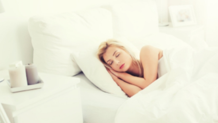 young-woman-sleeping-in-bed-at-home-bedroom-PVF5AEK.jpg