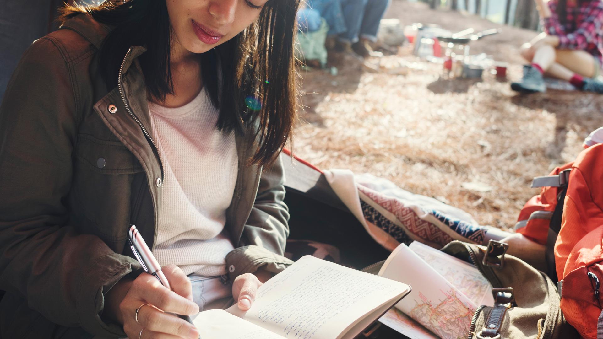 woman-reading-traveling-destination-camping-P6QJNYP.jpg