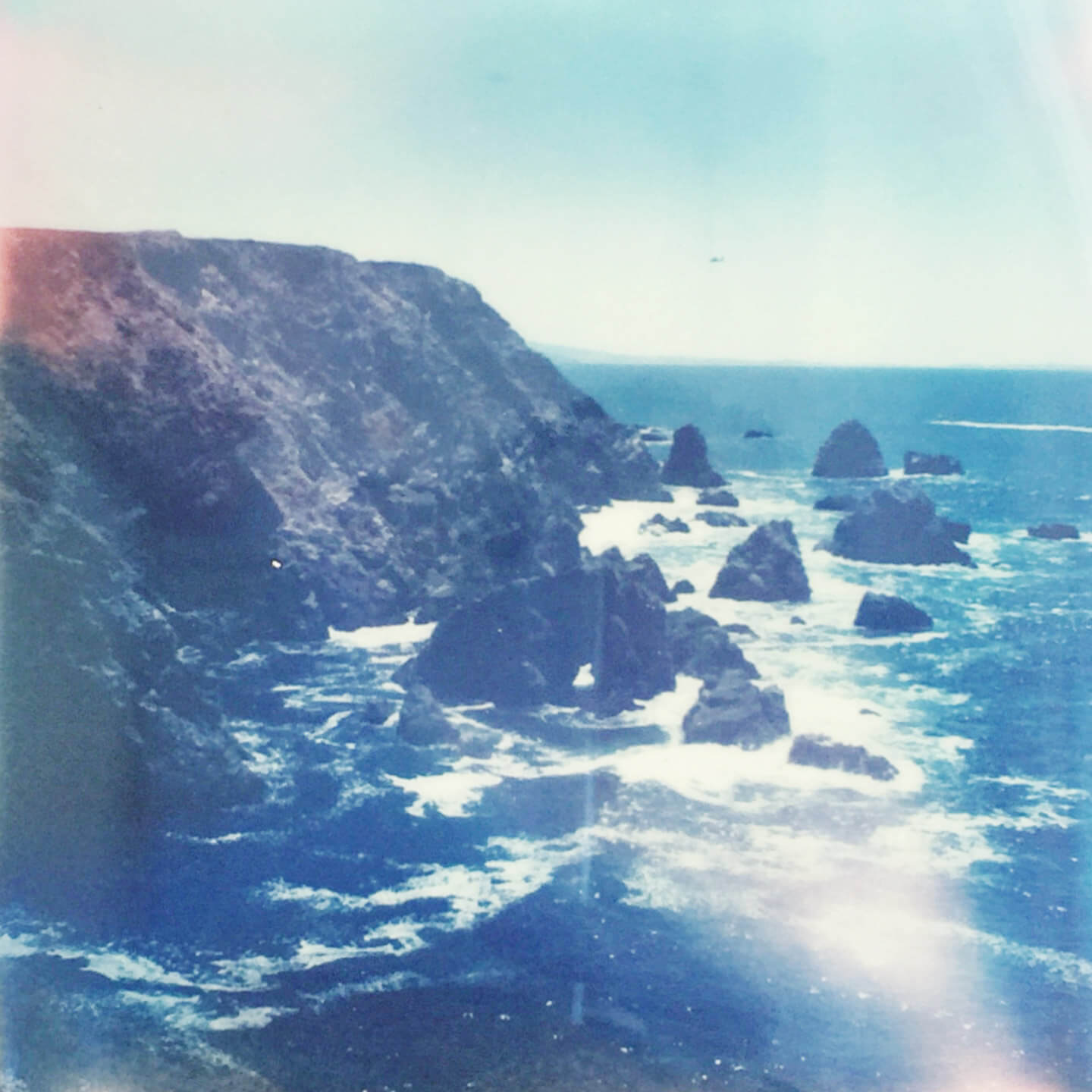 Polaroid of ocean coastline by The Qurious Effect | A Squarespace Web Design Studio